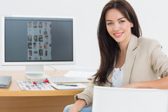 Female artist at desk with computer in the office Stock Image