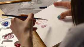Female artist drawing artwork at home with brush.  stock footage
