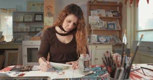 Female artist drawing in her studio