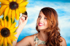 Female artist drawing sun flowers during summer Royalty Free Stock Photos