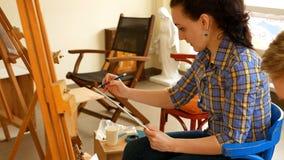 Female artist draws a pencil sketch in art studio Stock Photography