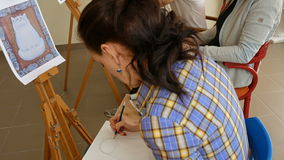 Female artist draws a pencil sketch in art studio stock video footage