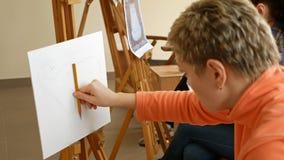 Female artist draws a pencil sketch in art studio stock footage