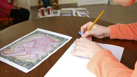 Female artist draws a pencil sketch in art studio stock video