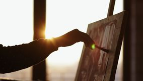 Female artist hand filling out the space on the canvas with paint. Professional art craft. Female artist hand filling out the space on the canvas with paint stock footage