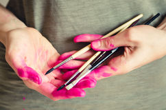 Female artist hands covered with pink paint Stock Photography