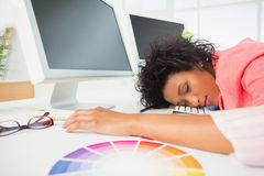Female artist with head resting on keyboard Stock Image