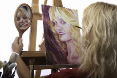 Female artist in her fifties painting Stock Photos