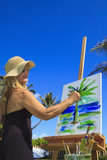 Female artist in her fifties painting Stock Photography
