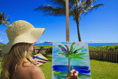Female artist in her fifties painting Royalty Free Stock Images