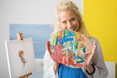 Female artist holding color palette in her studio Royalty Free Stock Photo