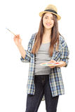 Female artist holding paintbrush and color pallet. Isolated on white background stock image
