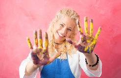 Female artist with paint on her hands Stock Image
