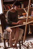 Female artist painter in her studio Royalty Free Stock Images