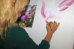Female artist painting Royalty Free Stock Photo