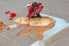 Female artist painting The Birth of Venus on pavement near Calima stock images