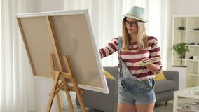 Female artist painting on a canvas stock video footage