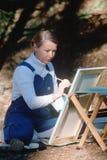 Female artist painting en pleine air Stock Photo