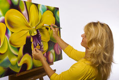 A female artist painting in her studio Royalty Free Stock Images