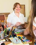 Female artist painting portrait of woman Stock Photos