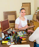 Female artist painting portrait of woman Stock Photography