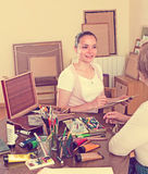 Female artist painting portrait of woman Royalty Free Stock Photos