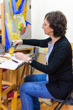 Female artist painting studio easel Stock Photos