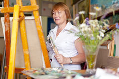Female artist paints a picture Royalty Free Stock Image
