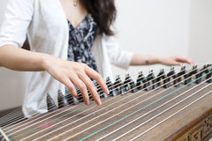 Female artist playing the Guzheng, a traditional chinese musical Royalty Free Stock Photography