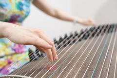Female artist playing the Guzheng, a traditional chinese musical Stock Images