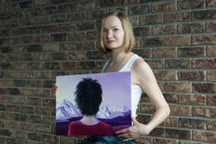 Female artist with short blonde hair royalty free stock photos