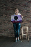 Female artist with short blonde hair stock photo