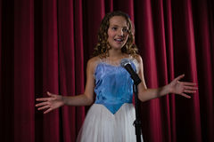 Female artist singing song on stage Royalty Free Stock Photo