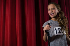 Female artist singing song on stage Stock Photography