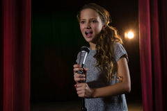 Female artist singing song on stage Royalty Free Stock Images