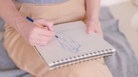 Female artist sitting sketching pad project idea. Female artist sitting sketching. Concentration learning. Sketch pad closeup. Hobby leisure time. New project stock video
