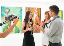 Female artist talking about her works Royalty Free Stock Images