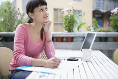 Female Artist Thinking And Drawing Royalty Free Stock Photo