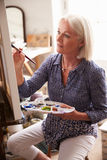 Female Artist Working On Painting In Studio Royalty Free Stock Photo