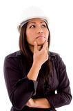 Female asian architect thinking. And wearing hardhat with white background Royalty Free Stock Photos