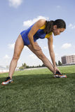 Female Asian Athlete Working Out On Field Royalty Free Stock Image