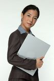 Female asian business executive. A female executive with laptop Stock Images