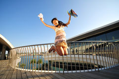 Female Asian chinese Tourist jumping with joy Stock Image