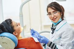 Female asian dentist doctor at work Stock Image