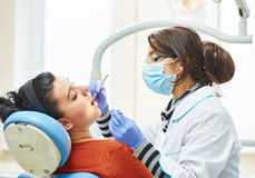Female asian dentist doctor at work Stock Photo