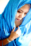Female Asian in head scarf. royalty free stock photos