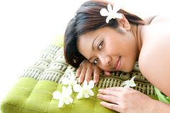 Female Asian relaxing in oriental spa Stock Photo