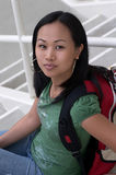 Female Asian Student with Backpack. On Steps Royalty Free Stock Photo