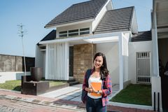 Female asian student in front of her house. Portrait of female asian student in front of her house ready to go to college royalty free stock images