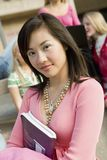Female Asian Student Holding Book Royalty Free Stock Photography